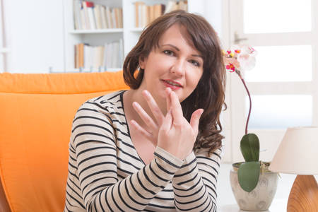 techniques: Woman doing EFT on the finger point. Emotional Freedom Techniques, tapping, a form of counseling intervention that draws on various theories of alternative medicine. Stock Photo