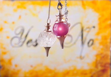 Pendulums, tool for dowsing over yes and no choosing diagram
