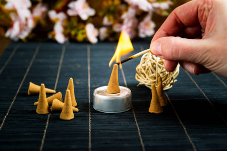 Traditional natural incense cones lighting with maches 版權商用圖片