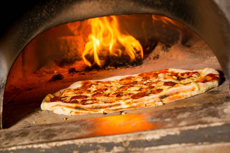 fire bricks: Fresh original Italian pizza in a traditional wood-fired stone oven.