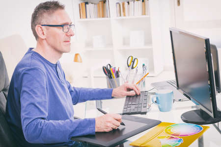 digitized: Designer using graphics tablet in the office Stock Photo