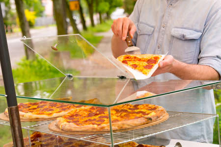 italy street: A street food vendor selling pizza by slice outdoors Stock Photo