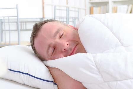 peacefully: Man peacefully sleeping at home
