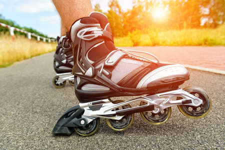 Roller blading outdoors, male legs