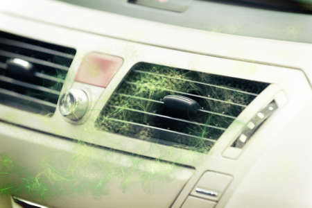 Concept of dirty air coming out from car ventilation system 스톡 콘텐츠