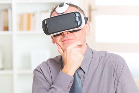 virtual office: Businessman using virtual reality headset at the office