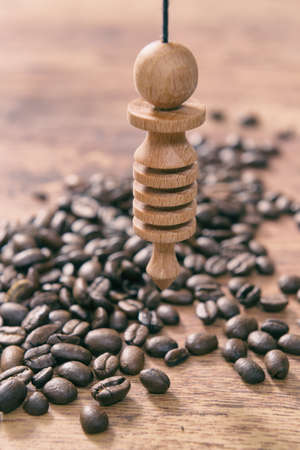 Using pendulum over coffee beans to check its quality Stock Photo