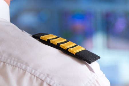 Close up of captains epaulettes in the cockip of commercial airplane