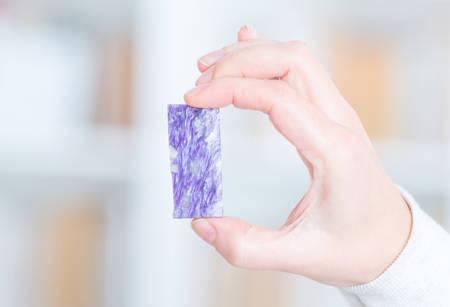 gemology: Charoite rare preciouse gemstone in hand