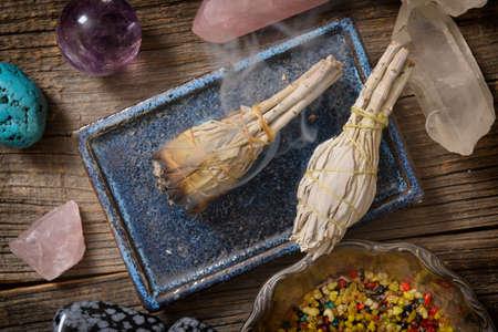 Burning natural white sage incense and multiple gemstones Archivio Fotografico