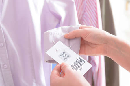 Woman's hands with a barcode label in a shop