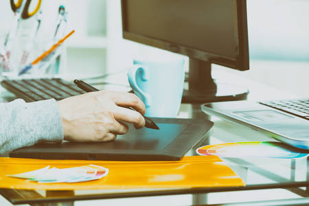 Designer using graphics tablet in the office Stock Photo