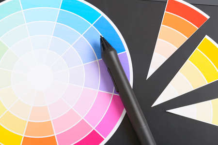 stylus: Color wheel and swatches of colour with stylus on a graphic tablet Stock Photo