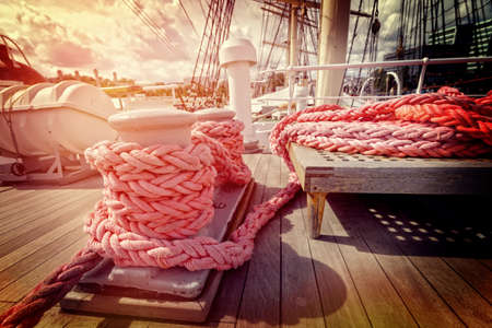 Ropes on a wooden deck of big old sailboat Stock Photo