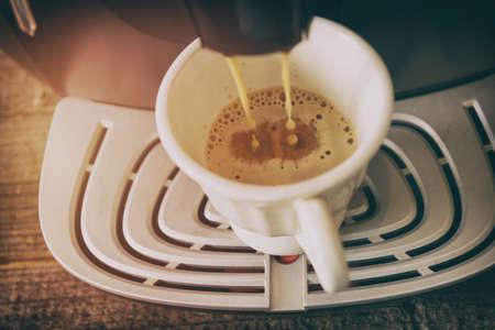 Coffee machine making fresh coffee crema Stock Photo