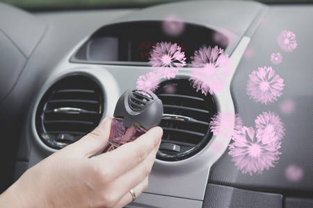 Car air freshner mounted to ventilation panel, fresh flower scent Stockfoto - 101705488
