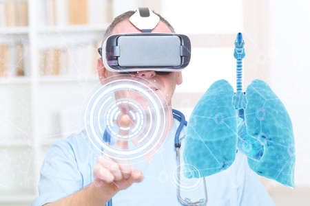 Medical doctor using virtual reality headset at his work with lungs Imagens