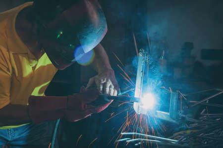 Industrial Worker at the factory or workshop welding steel elements Stock fotó
