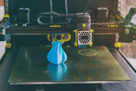 Modern 3d printer with printed three dimentional model of vase at home, Фото со стока