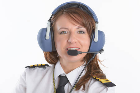 Beautiful woman pilot with headset used in aircraft Standard-Bild
