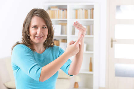 Woman doing EFT on the karate chop point. Emotional Freedom Techniques, tapping, a form of counseling intervention that draws on various theories of alternative medicine. Фото со стока