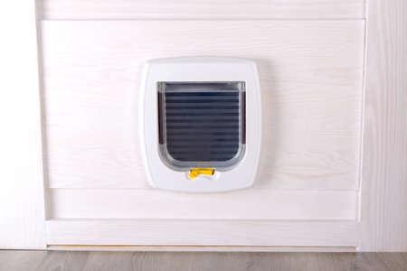 White plastic cat door, enterance to cat litter box or outside Zdjęcie Seryjne