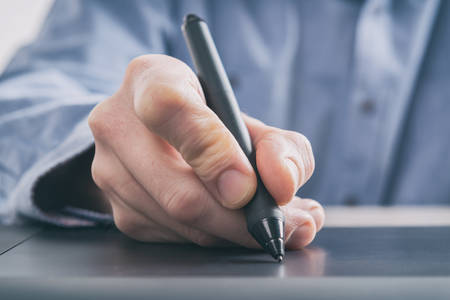 Man using modern graphical tablet