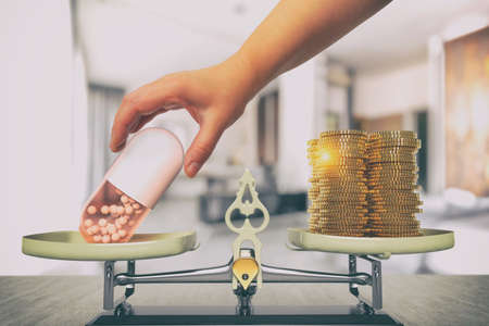 Scale, medicine and money. The concept of expensive treatment, insurance or another idea.