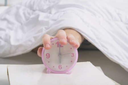 Hand on clock, time to wake up