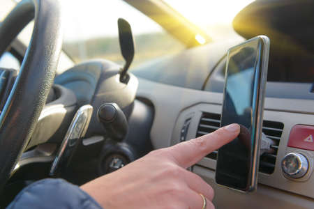 Woman using phone while driving the car. Risky driving behaviors concept