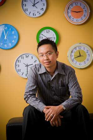 Asian businessman with clocks on the wall  photo