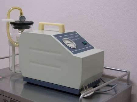 suction: A medical medi-vac vacuum suction unit