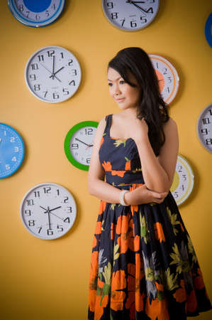 Asian woman with clocks photo