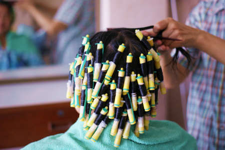 permanent wave: hair curling Stock Photo