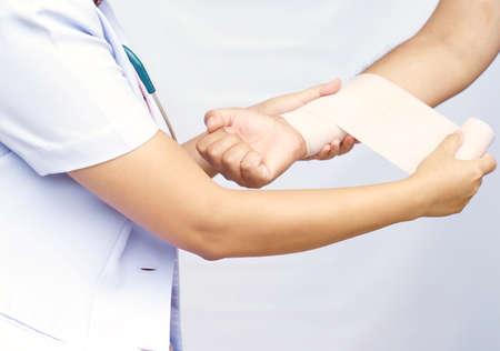 arm pain: Doctor imposes bandage Stock Photo
