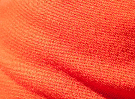 Colorful textile close up in bright orange photo