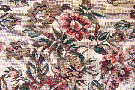 Fragment of retro tapestry fabric pattern with colorful floral ornament on white background  photo