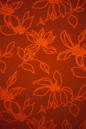 weaved: An exotic orange color  floral pattern weaved fabric as textural background. Stock Photo