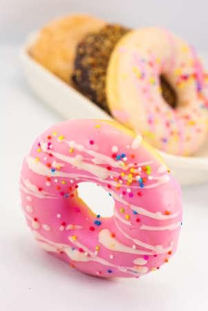 Group of glazed donuts, isolated on white background photo
