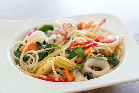 Spaghetti Seafood with Chili   Basil Stock Photo - 26004898