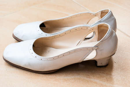 trash the dress: Old white Shoes