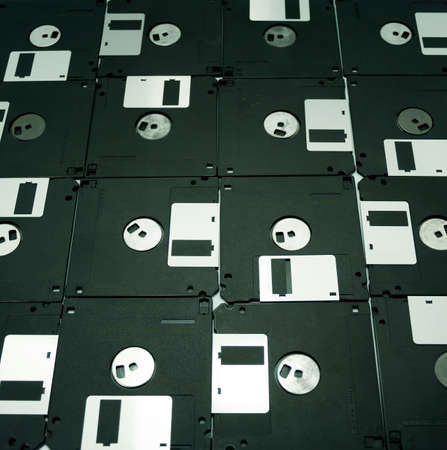 Old floppy disk, and USB port ,memory innovation concept Stock Photo