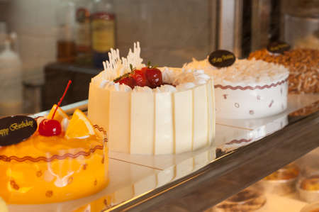 Window of a cake shop with a variety of cakes on display Stock Photo