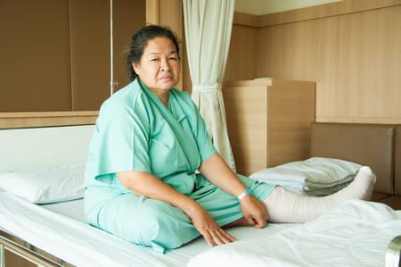 senior woman with broken leg in hospital photo