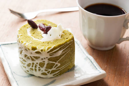 Japanese confectionery, green tea and red bean swiss roll photo