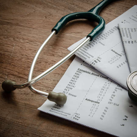 stethoscope and laboratory result, Medical insurance concept. photo