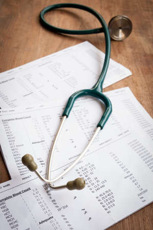 diagnoses: A stethoscope on the top of a blood test result