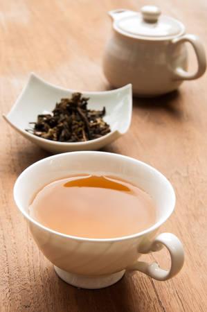 tea cup full of tea photo