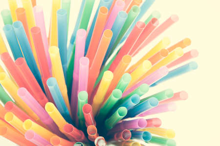 Colored plastic drinking straws on a white background photo