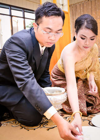 Bride and groom in thai traditional wedding photo